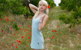 Beautiful Teen Posing with her Young Naked Body in the Middle of the Meadow